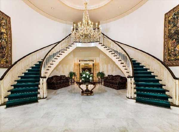 The grand entry will dazzle you with its soaring foyer and antebellum-style dual staircases! From the foyer you can see through the grand hall to the lake through a wall of windows. <span class=meta>( www.hilcoreal.com)</span>