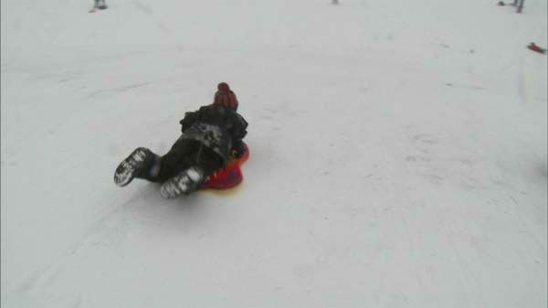 A child sleds on New Year&#39;s Day 2014.  <span class=meta>(ABC 7 Chicago)</span>