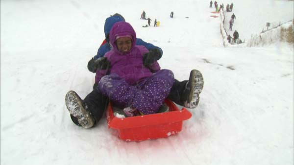 Children sled on New Year&#39;s Day 2014.  <span class=meta>(ABC 7 Chicago)</span>