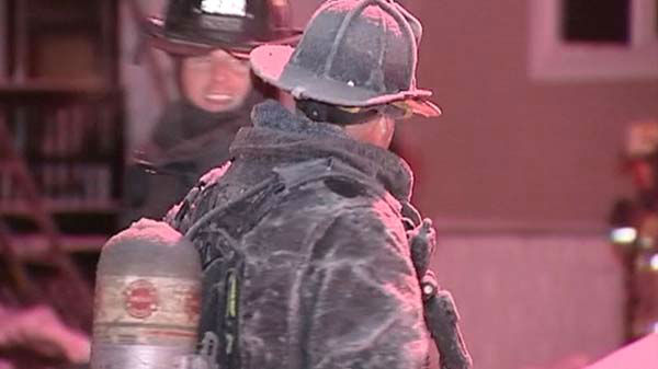 "<div class=""meta image-caption""><div class=""origin-logo origin-image ""><span></span></div><span class=""caption-text"">Chicago Fire Department crews were coated in ice  after being sprayed by water while fighting a fire near 52nd Street and Lowe overnight January 6, 2014.  (WLS Photo)</span></div>"