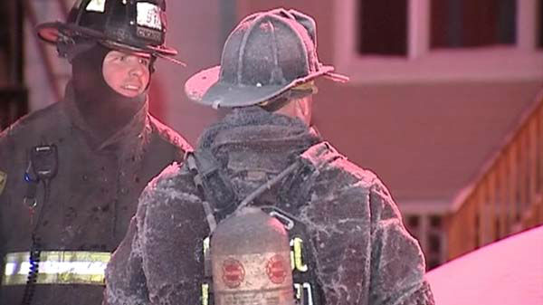 Chicago Fire Department crews were coated in ice  after being sprayed by water while fighting a fire near 52nd Street and Lowe overnight January 6, 2014.  <span class=meta>(WLS Photo)</span>
