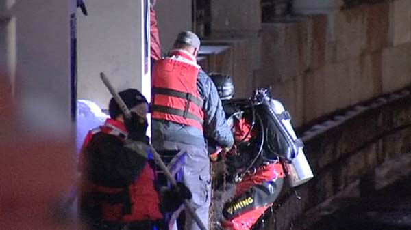 "<div class=""meta image-caption""><div class=""origin-logo origin-image ""><span></span></div><span class=""caption-text"">Two men were pulled from the icy Chicago River early Monday morning. One of them died. Dive teams are searching for a third person, who is presumed dead. </span></div>"
