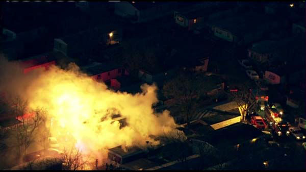 "<div class=""meta ""><span class=""caption-text "">Flames roared through at least one trailer at a trailer park near Des Plaines Tuesday morning.  (WLS Photo/ Chopper 7)</span></div>"
