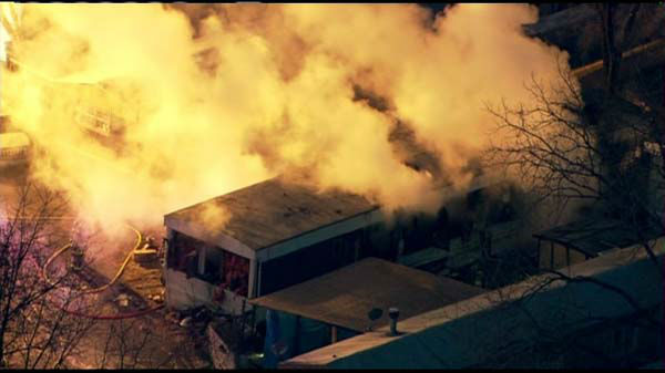 Flames roared through at least one trailer at a trailer park near Des Plaines Tuesday morning.  <span class=meta>(WLS Photo&#47; Chopper 7)</span>