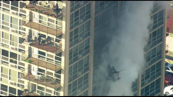 Fire crews responded Tuesday to the scene of a fire burning on the eighth floor of a South Shore high-rise building.