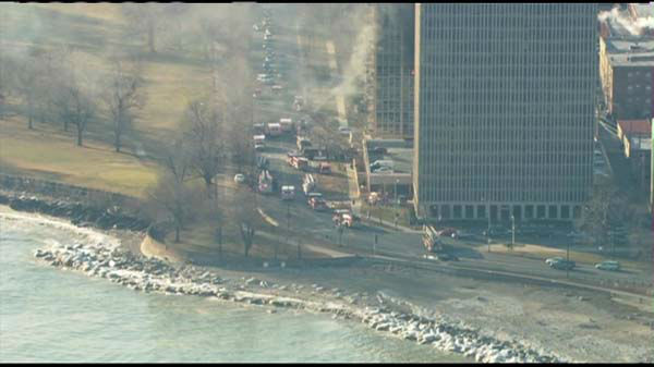 "<div class=""meta image-caption""><div class=""origin-logo origin-image ""><span></span></div><span class=""caption-text""> Fire crews responded Tuesday to the scene of a fire burning on the eighth floor of a South Shore high-rise building.</span></div>"
