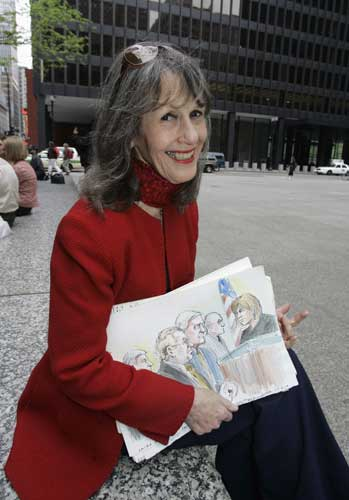 In this May 14, 2008 file photo, courtroom sketch artist Andy Austin poses at Chicago&#39;s Federal Plaza with one of her works from the corruption trial of Conrad Black. Austin has worked as a court artist for 40 years. Artists have been drawing legal proceedings since the Salem witch trials to the recent corruption trial of impeached Gov. Rod Blagojevich, but their ranks are thinning as states lift courtroom camera bans. Just 14 states still have the prohibitions in place, though three of those states, Minnesota, South Dakota and Illinois, recently moved to end theirs. <span class=meta>(AP Photo&#47;Charles Rex Arbogast, File)</span>