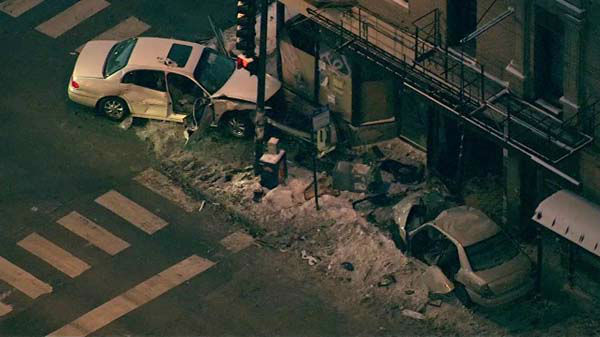 Logan Square crash injures eight people when two cars slam into building at Fullerton and Kimball. <span class=meta>(WLS Photo)</span>