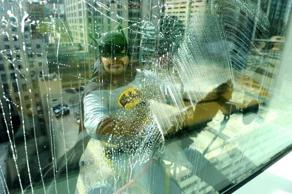 Captain America and Batman swung into action at the hospital, washing patients' windows.