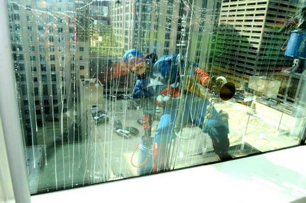 The superheroes were actually window washers from Corporate Cleaning. The group said their mission was to put a smile on the faces of the children battling illness at the hospital.