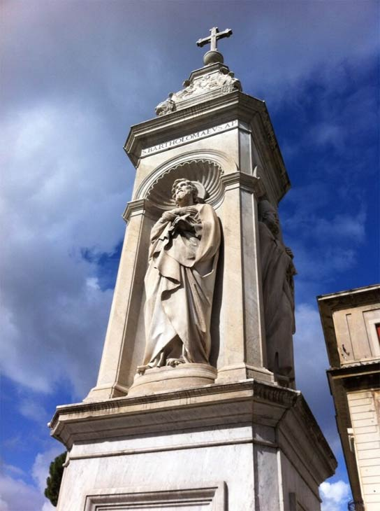 Photo by Alan Krashesky (@KrasheskyABC7): St. Bartholomew statue outside Cardinal #George 's assigned church in #Rome.