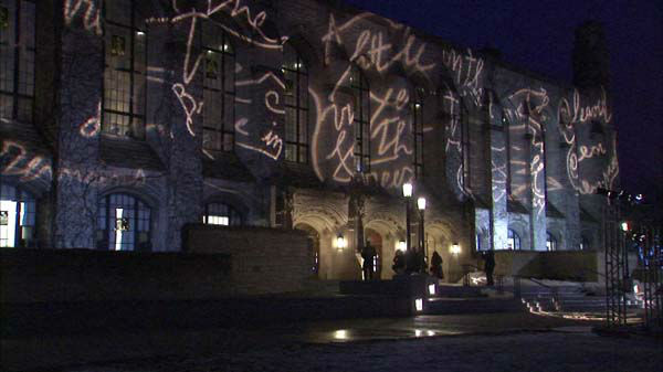"<div class=""meta image-caption""><div class=""origin-logo origin-image ""><span></span></div><span class=""caption-text"">A poem, written with lights,  is projected onto the outside of Deering Library at Northwestern University. The artist, Marco Nereo Rotelli, is known for his light installations.  (WLS Photo)</span></div>"