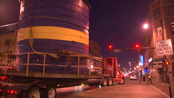 "<div class=""meta image-caption""><div class=""origin-logo origin-image ""><span></span></div><span class=""caption-text"">About 16 hours after the job began, that water tank is now in its new temporary home, the Swedish American Museum parking lot at Foster and Ashland.</span></div>"