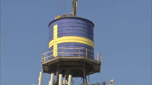 "<div class=""meta image-caption""><div class=""origin-logo origin-image ""><span></span></div><span class=""caption-text"">An Andersonville landmark came down on Thursday, March 20, 2014, after 85 years. Investigators determined the water tower on top of the Swedish American Museum was unsafe.</span></div>"