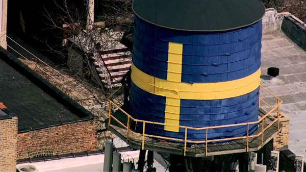 "<div class=""meta image-caption""><div class=""origin-logo origin-image ""><span></span></div><span class=""caption-text"">The water tower tank was built in 1927 and sat atop the Swedish American Museum. The Swedish flag painted on it a decade or so ago, cementing its role as an Andersonville landmark. </span></div>"