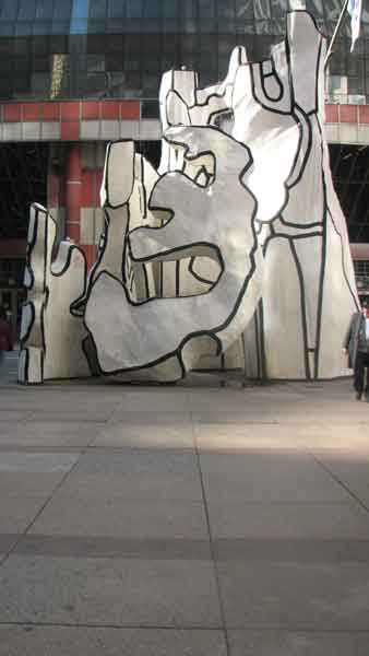 "<div class=""meta ""><span class=""caption-text "">Standing in front of an art form itself, the ""Monument with Standing Beast"" captures attention with different reactions from tourists and locals. Made from fiberglass, this 10-ton work of art was sculpted by Jean Dubuffet and stands in front of the James R. Thompson Center in Chicago's Loop. It depicts a standing animal, a tree, a portal and an architectural form, but Chicagoans refer to it as, ""Snoopy in a blender."" This sculpture is located at 100 W. Randolph St.  (Joanna Wesoly/ABC 7 Chicago)</span></div>"