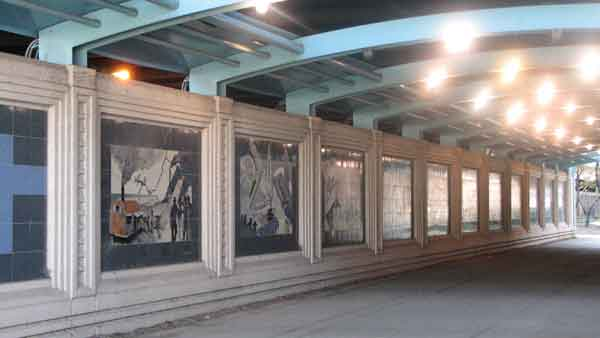 "<div class=""meta ""><span class=""caption-text "">Ellen Lanyon's Riverwalk Gateway tells a story using pictures. Located where the Chicago River meets the lake, Lanyon's mural takes viewers on the same path as Jacques Marquette and Louis Jolliet in 1673, celebrating important events until the year 2000. Using ceramic tiles to tell a story, Lanyon cites events such as The Great Fire and the reversal of the Chicago River. This mural is located at Lake Shore Drive and Wacker Dr.  (Joanna Wesoly/ABC 7 Chicago)</span></div>"