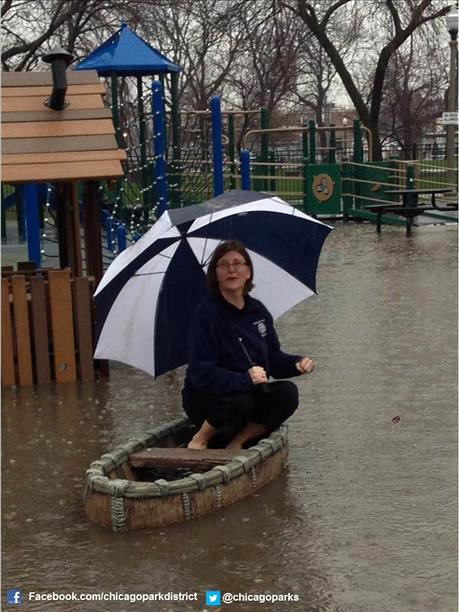 Portage Park Supervisor, Deb Groh, attempts to navigate through her flooded playground with a boat today. For a list of Chicago Park District locations being affected by the severe weather, go here: http://www.chicagoparkdistrict.com/parks/park-flooding/
