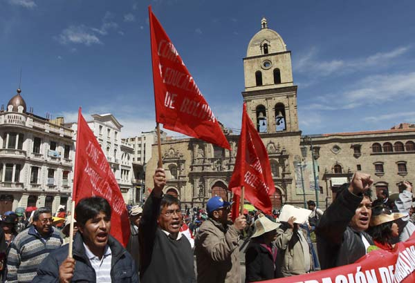 Demonstrators shout slogans against Bolivia's President Evo Morales and his government during a May Day march in La Paz, Bolivia, Tuesday, May 1, 2012. Morales announced Tuesday his government is completing the nationalization of the country's electricity industry by taking over its electrical grid from a Spanish-owned company. (AP Photo/Juan Karita)