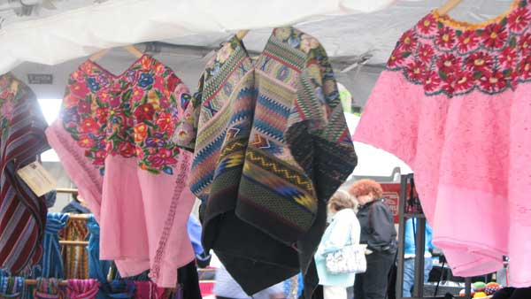 Chicago hosted an annual celebration in honor of World Fair Trade Day at the Daley Plaza on May 9, 2012. The Chicago Fair Trade organization filled the plaza with booths containing clothing, accessories and coffee from Fair Trade companies in the area such as Malia Designs and Venture Imports. <span class=meta>(ABC 7 Chicago&#47;Joanna Wesoly)</span>