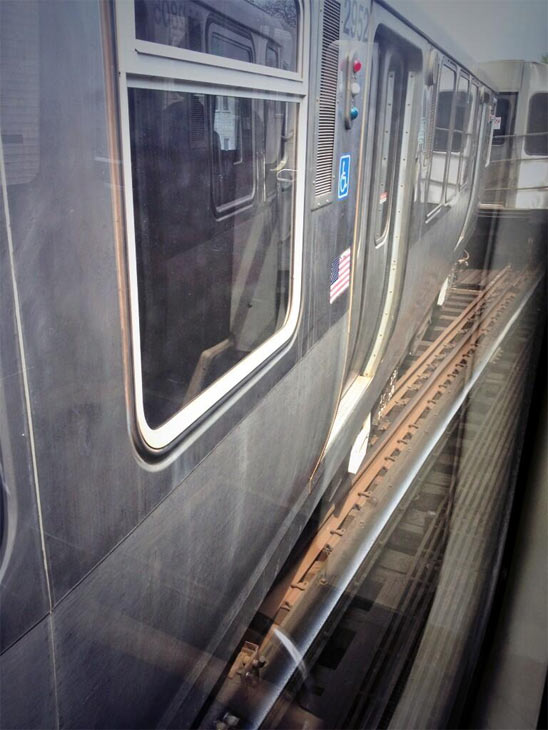 "<div class=""meta ""><span class=""caption-text "">A CTA Red Line train derailed in the Lincoln Park neighborhood, Thursday, May 9, 2013, disrupting service on the Brown and Red lines. (Image courtesy Allie Leddon)</span></div>"