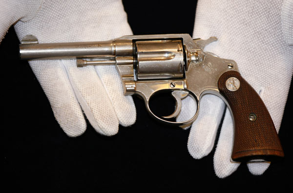 "A handgun once owned by notorious gangster ""Al"" Capone, is displayed at Christie's auction house, London, Tuesday, June 21, 2011. The Colt .38 revolver will be going up for auction this week, and is expected to sell for between 50,000 pounds ($80,899/56,650 euro) and 70,000 pounds ($113,258/79,315 euro). (AP Photo/Tim Hales)"
