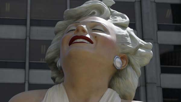 "<div class=""meta ""><span class=""caption-text "">The face of Marilyn Monroe smiles on Seward Johnson's 26-foot-tall sculpture of Monroe, in her most famous wind-blown pose, on Michigan Ave. Friday, July 15, 2011 in Chicago.  (AP Photo/Charles Rex Arbogast)</span></div>"