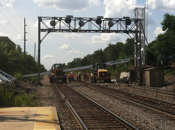 "<div class=""meta ""><span class=""caption-text "">Image submitted by Joey W. via Useeit. A crane has tipped over and is blocking the Burlington Northern Santa Fe railroad tracks in Westmont. Train service is not expected to resume for at least two hours. There were no injuries. Metra says ""extensive"" delays are possible along its BNSF line Wednesday afternoon, and has already reported on its website that trains have not been operating beyond Westmont. </span></div>"