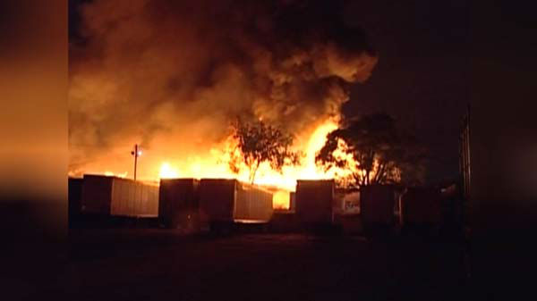 "<div class=""meta ""><span class=""caption-text "">A massive fire at a Brighton Park warehouse rekindled early Thursday morning on the city's Southwest Side. (WLS Photo)</span></div>"