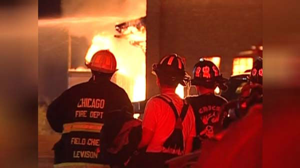 "<div class=""meta image-caption""><div class=""origin-logo origin-image ""><span></span></div><span class=""caption-text"">A massive fire at a Brighton Park warehouse rekindled early Thursday morning on the city's Southwest Side. (WLS Photo)</span></div>"