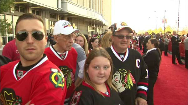 The 2013 Stanley Cup Champion Blackhawks were greeted by fans as they arrived for the season opener at Chicago&#39;s United Center on Tuesday, October 1, 2013.  <span class=meta>(WLS Photo)</span>