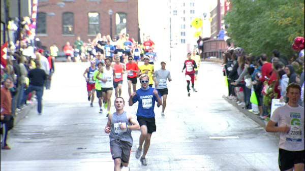 Thousands of runners hit the streets and millions lined the route amidst tight security for the 2013 Chicago Marathon on October 13, 2013