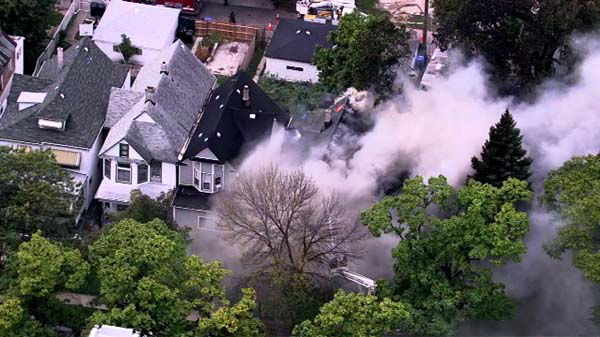 "<div class=""meta image-caption""><div class=""origin-logo origin-image ""><span></span></div><span class=""caption-text""> A fire spread from one home to two neighboring buildings in the 6700-block of South Emerald on the city's South Side.  (WLS Photo)</span></div>"