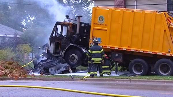 At least one person was killed when a passenger vehicle and garbage truck collided in northwest suburban Glenview on October 15, 2013. <span class=meta>(WLS Photo)</span>