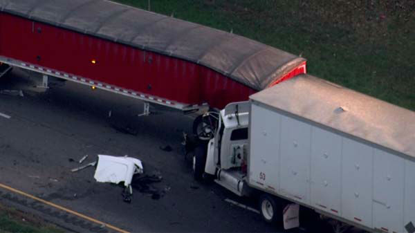 "<div class=""meta ""><span class=""caption-text "">A crash involving three semi-trucks and at least three cars shut down all lanes of southbound I-55 at Bluff Road on Wednesday, October 16, 2013. </span></div>"