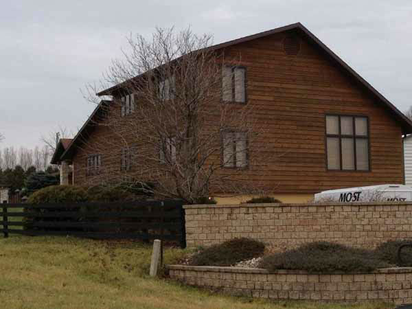 "<div class=""meta ""><span class=""caption-text "">Exterior shot of home. The U.S. Marshals offered a glimpse inside the homes of disgraced former Dixon comptroller Rita Crundwell, Dec. 7, 2012. (Photos by Ravi Baichwal)</span></div>"
