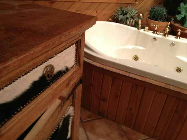 "<div class=""meta ""><span class=""caption-text "">Custom bathroom outfitted in wood. The U.S. Marshals offered a glimpse inside the homes of disgraced former Dixon comptroller Rita Crundwell, Dec. 7, 2012. (Photos by Ravi Baichwal)</span></div>"
