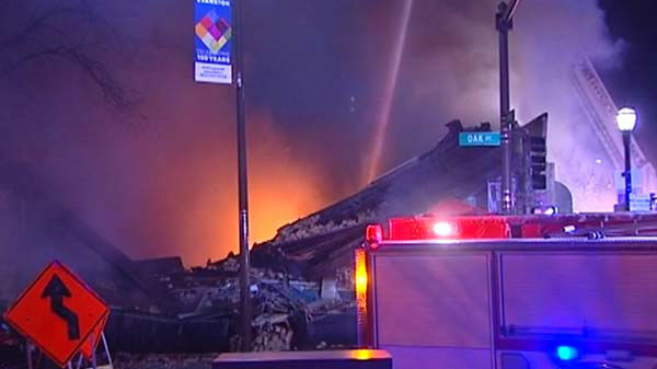 An early morning fire ripped through a commercial building at the intersection of Davis and Oak in north suburban Evanston.   <span class=meta>(WLS Photo)</span>
