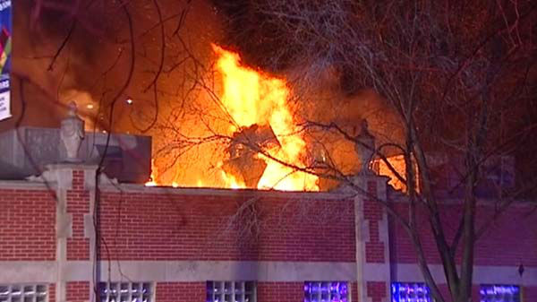 "<div class=""meta ""><span class=""caption-text "">An early morning fire ripped through a commercial building at the intersection of Davis and Oak in north suburban Evanston.   (WLS Photo)</span></div>"