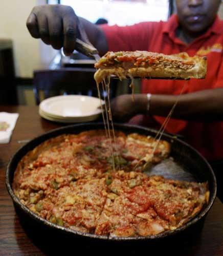 "<div class=""meta ""><span class=""caption-text "">No. 1: When it comes to pizza, Chicago is my kind of town. The Second City takes first place when it comes pizza, according to  Travel and Leisure magazine. Not only is that deep dish, Chicago-style pizza hard to find outside the area, the ""tavern-style"" thin crust gets top billing, too.  ([FILE] A server dishes up a slice of deep dish pizza Friday, March 30, 2007, at Lou Malnati's Pizza in Chicago. AP Photo/M. Spencer Green)</span></div>"