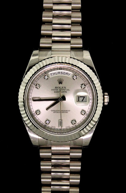 WATCH: (1) Men's 18k WG Rolex O.P. Day Date II wristwatch; 42mmOD case; silver dial w/ 2 bag & 8 rd diamonds = est. 0.20cttw, EX/E-F/VVS; 18k WG fluted bezel; President link bracelet (83219/P1F), 7 removable screw links; Model 218239; Mvmt 3 4965181 (3156); Serial G452258 (2010). Note: Box present, factory protective plastics on case, 5/2012 purchase date.   Full auction listing here