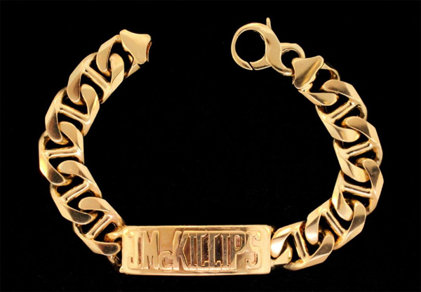 "BRACELET: (1) 14ky bracelet. 10"" in length with a gold weight of 99 dwt. In the center of the bracelet is a 2"" bar with the name J McKillips in raised letters. The bracelet is Gucci design 16m wide   Full auction listing here"