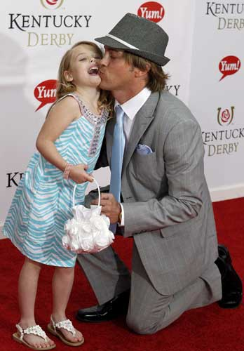 Larry Birkhead kisses Anna Nicole Smith&#39;s daughter Dannielynn as they arrive for the 137th Kentucky Derby horse race at Churchill Downs Saturday, May 7, 2011, in Louisville, Ky.  <span class=meta>(AP Photo&#47;Darron Cummings)</span>