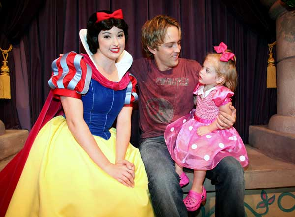 In this image released by Disneyland, Larry Birkhead and his daughter Dannielynn, 2, visit Snow White at the Princess Fantasy Faire at Disneyland in Anaheim, Calif. on Thursday, Sept. 18, 2008. (AP Photo/Disneyland, Scott Brinegar)