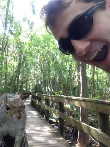 In this photo made Saturday April, 26, 2014, and provided by Brian Genest, a squirrel approaches Brian Genest as he takes a photo of himself at John Chestnut Park near Tampa, Florida.  <span class=meta>(AP Photo&#47;Brian Genest)</span>
