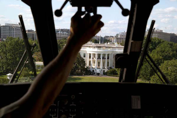 July 25, 2013 Marine One approaches the South Lawn of the White House. I had asked the President&#39;s military aide if the pilot would let me photograph the approach from the cockpit, which yielded this photograph.   <span class=meta>(Official White House Photo by Pete Souza)</span>