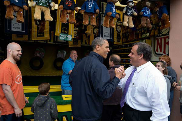 May 28, 2013: The President congratulates New Jersey Gov. Chris Christie while playing the &#34;TouchDown Fever&#34; arcade game along the Point Pleasant boardwalk in Point Pleasant Beach, N.J. The President toured the boardwalk which had reopened following the devastation of Hurricane Sandy in 2012.   <span class=meta>(Official White House Photo by Pete Souza)</span>