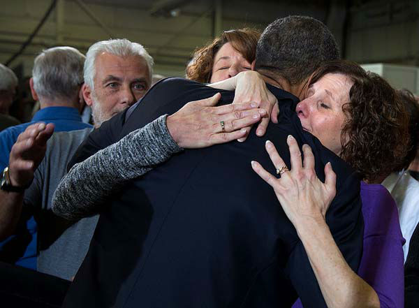 April 3, 2013: The President hugs Sue Connors and Jane Dougherty, right, following his remarks at the Denver Police Academy in Denver, Colo. The women lost their sister, Mary Sherlach, in the Sandy Hook Elementary School shootings in Newtown, Conn.   <span class=meta>(Official White House Photo by Pete Souza)</span>