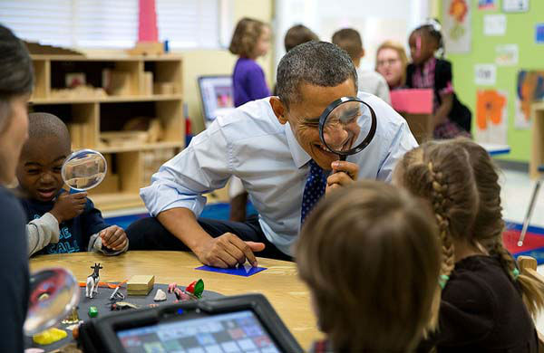 The President genuinely enjoys being with kids. Here, he played a magnifying glass game with children during a visit to a pre-kindergarten classroom at the College Heights Early Childhood Learning Center in Decatur, Georgia. <span class=meta>(Official White House Photo by Pete Souza)</span>