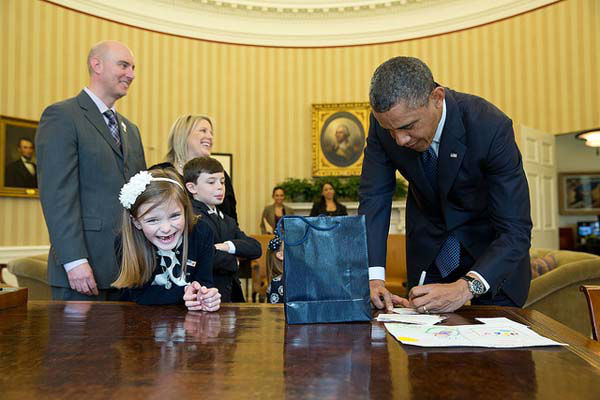 March 26, 2013: The President signs memorabilia in the Oval Office for an overjoyed Nina Centofanti, 8, the 2013 March of Dimes National Ambassador.  <span class=meta>(Official White House Photo by Pete Souza)</span>